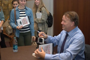 Lawrence Cunningham signs books and talks with students after his lecture Tuesday.
