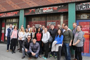 Gabelli School of Business MBA cohort students stand outside the Upright Citizens Brigade Theatre.