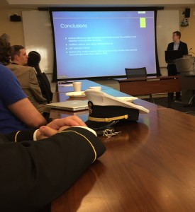 Attendees listen to a presentation at the Gabelli School of Business Undergraduate Business Research Conference.
