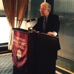 Author Robert Pozen speaks to a group of Fordham alumni in Boston.