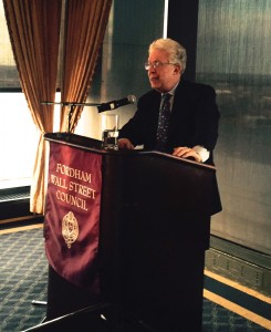 Author Robert Pozen speaks to a group of Fordham alumni in Boston.