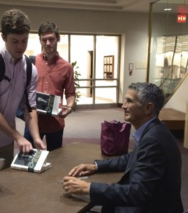 Charles Brandes signs copies of his book, Brandes on Value, for Fordham students following his talk on Sept. 9, 2015.