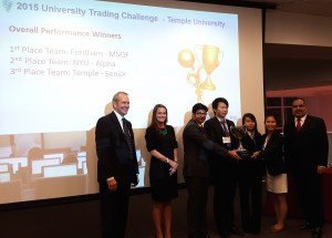 Standing with the University Trading Challenge organizers, the four winning Fordham MSQF students, from left, Siddarth, Zhifang Sun, Qi Zhou and Yiming Huang.