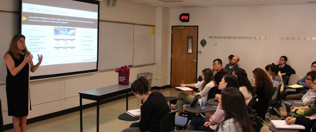 Sarah Quinlan, of MasterCard Advisors, talks to students during an International Business Week event.