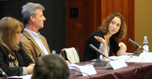 At right, Jacqueline LiCalzi, of Morgan Stanley, speaks while, from left, Cassandra Lentchner, also of Morgan Stanley, and Michael Herde, of Fidelity Investments, listen. The three were part of a panel on corporate compliance, held on Friday, Nov. 20, 2015.