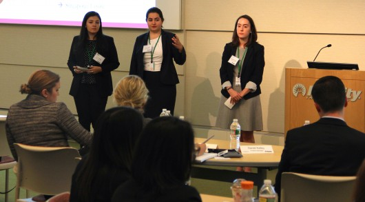 From left, Fordham University students Lorem Basile, Lauren Kelly and Elizabeth Fonger participate in a Smart Woman Securities stock-picking competition in Boston on Dec. 4, 2015.