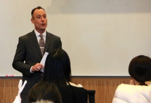 Michael O'Reilly, Brooks Brothers, speaks to a group of Fordham students during a presentation on professional attire. (Photo by Bailey Link)