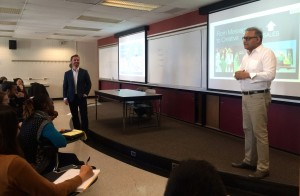 Chris Albert, senior vice president of digital analytics at Ketchum Global Research and Analytics, left, smiles as R.P. Kumar, executive vice president and global director of strategic planning at Ketchum, speaks to a group of Fordham graduate marketing students.