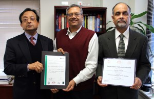 """From left, Sris Chatterjee, N.K. """"Chiddi"""" Chidambaran and Gautam Goswami, Fordham professors whose research into special purpose acquisition companies won the best paper award at the India Finance Conference in Deccember 2015."""
