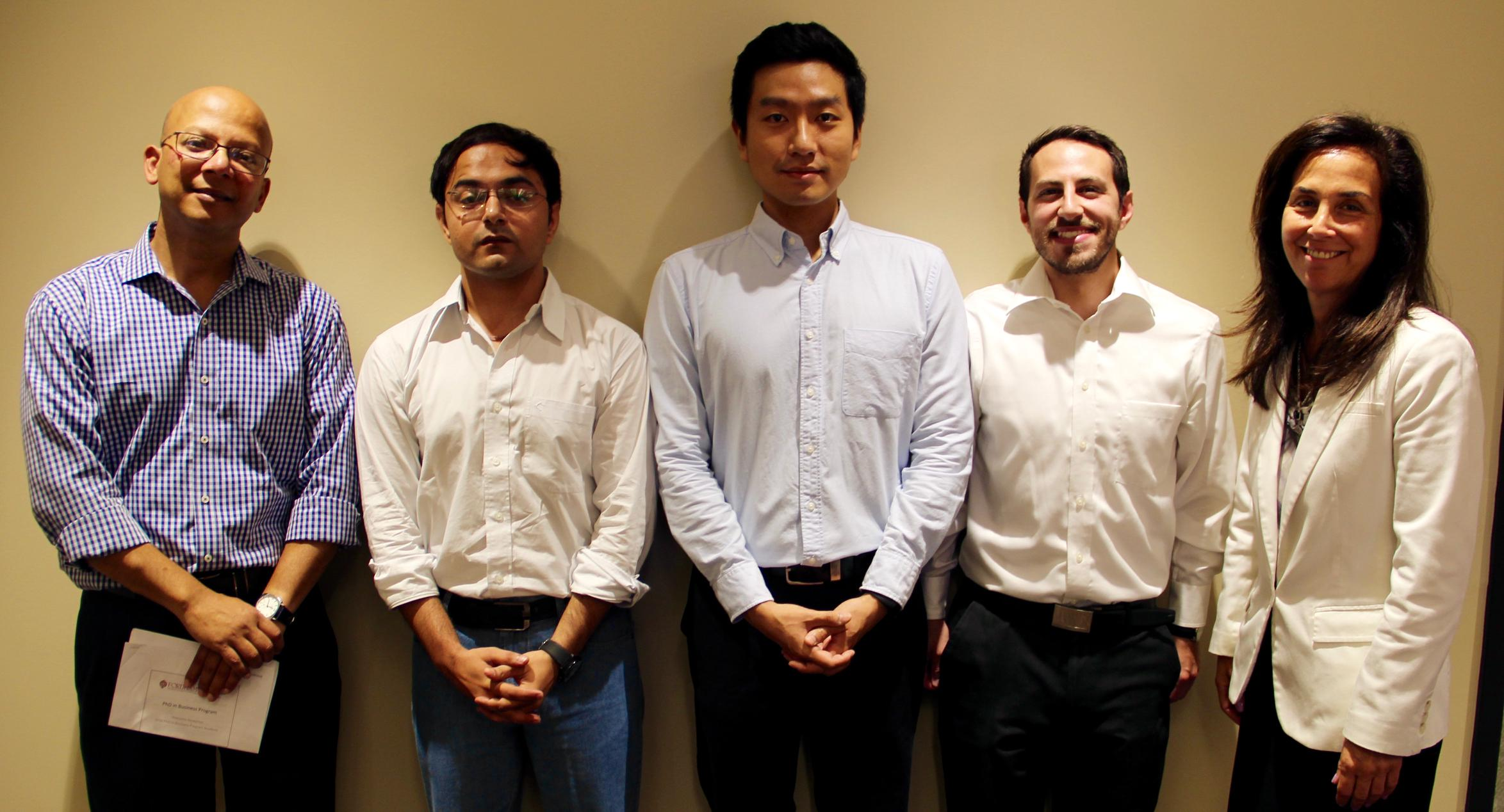 From left, Iftekhar Hasan, director of the PhD program; PhD students Jitendra Aswani, Joon Ho Kong, , and Joseph Micale; and Gabelli School Dean Donna Rapaccioli.