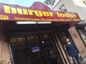 Ferso Ismail stands outside of his restaurant, Burger Lodge. Photo by Kate Marinkovich.